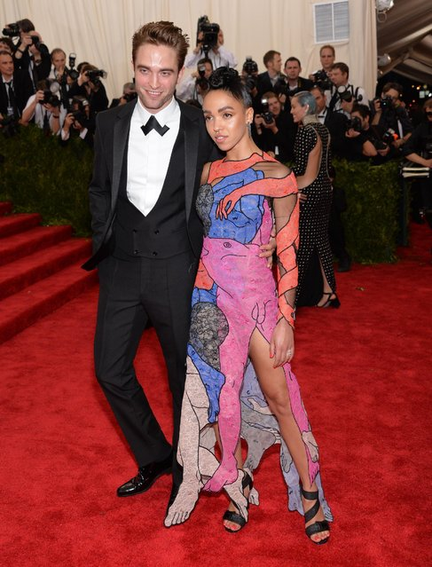 "Robert Pattinson and FKA Twigs arrives at The Metropolitan Museum of Art's Costume Institute benefit gala celebrating ""China: Through the Looking Glass"" on Monday, May 4, 2015, in New York. (Photo by Evan Agostini/Invision/AP Photo)"