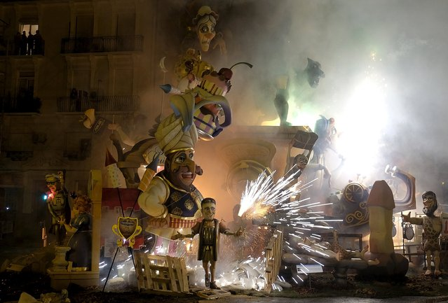 Fireworks explode as effigies start to burn during the finale of the Fallas festival, which welcomes spring and honours Saint Joseph's Day, in Valencia, Spain, early March 20, 2016. (Photo by Heino Kalis/Reuters)