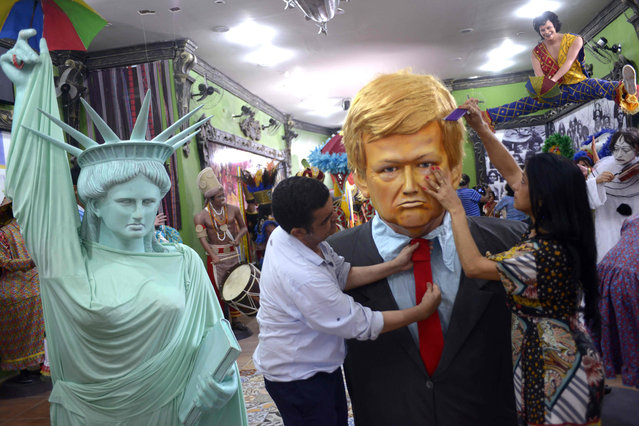 A large dummy representing US Preident Donald Trump to be used during the upcoming carnival parades is being readied at the Embaixada de Pernambuco dos Bonecos Gigantes de Olinda (Olinda Giant Dummies Pernambuco' s Embassy) tourism organization premises in Olinda, pernambuco, northeastern Brazil, on February 15, 2017. (Photo by Leo Caldas/AFP Photo)