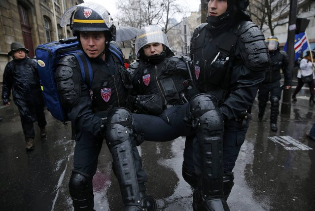 A French CRS riot police is evacuated during clashes with French high school and university students during a demonstration against the French labour law proposal in Paris, France, as part of a nationwide labor reform protests and strikes, March 31, 2016. (Photo by Benoit Tessier/Reuters)