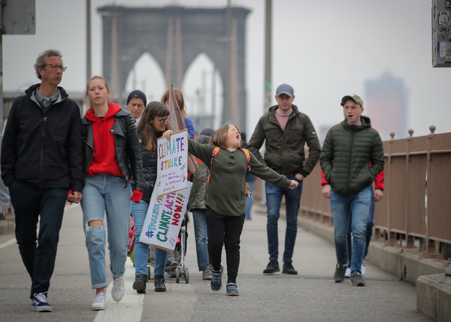 Climate change activist Zayne Cowie walks on the Brooklyn Bridge during a youth climate march in New York City, U.S., May 3, 2019. (Photo by Brendan McDermid/Reuters)