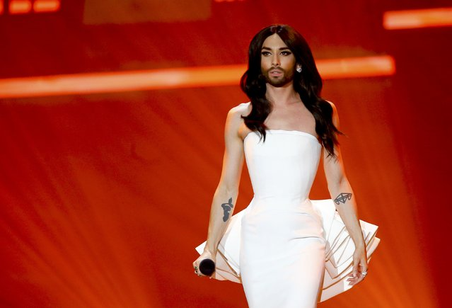 Last year's winner Conchita Wurst of Austria performs during the first semifinal of the upcoming 60th annual Eurovision Song Contest In Vienna, May 19, 2015. (Photo by Leonhard Foeger/Reuters)