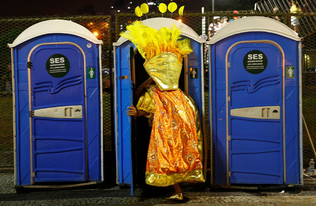 A reveller enters a chemical toilet before the first night of the Carnival parade of samba schools at the Sambadrome in Rio de Janeiro, Brazil, February 26, 2017. (Photo by Ricardo Moraes/Reuters)