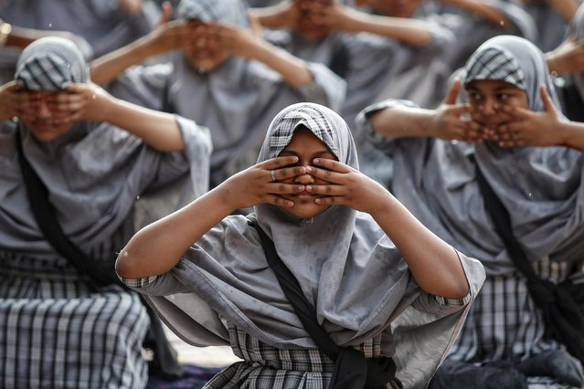 Muslim students attend a yoga lesson at a school ahead of International Yoga Day in Ahmedabad, India, June 18, 2019. (Photo by Amit Dave/Reuters)