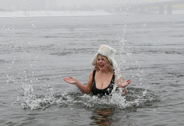Olga Olesnitskaya, a model of the SibPlus Models agency and a winner of the Miss Doughnut 2016 beauty competition, takes a bath in the icy waters of the Yenisei River in Krasnoyarsk, Siberia, Russia, March 4, 2017. (Photo by Ilya Naymushin/Reuters)