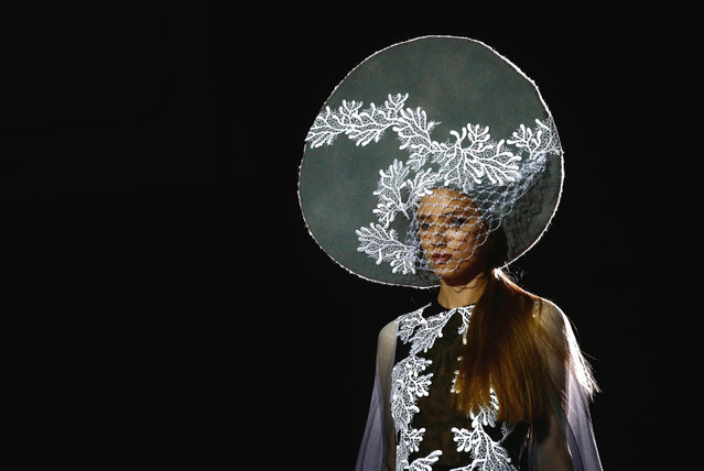 """A model wears a creation from """"Isabel Zapardiez"""" during Barcelona Bridal fashion week in Barcelona, Spain, Thursday, April 28, 2016. (Photo by Manu Fernandez/AP Photo)"""