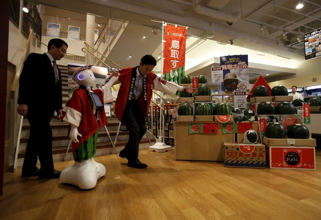 "SoftBank's human-like robot named ""Pepper"" makes its appearance as a PR manager of Tottori prefecture at the prefecture speciality store in Tokyo, Japan, July 1, 2015. (Photo by Yuya Shino/Reuters)"