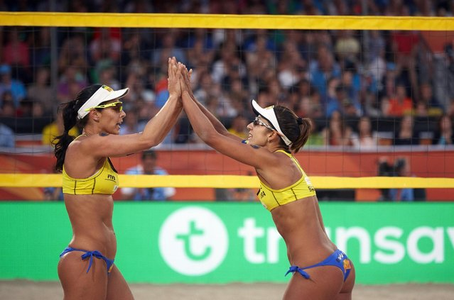 Agatha Bednarczuk, left and Barbara Seixas De Freitas from Brazil celebrate after winning the FIVB Beach Volleyball World Championships Women's final game in The Hague, Netherlands on Saturday, July 4, 2015. (Photo by Phil Nijhuis/AP Photo)