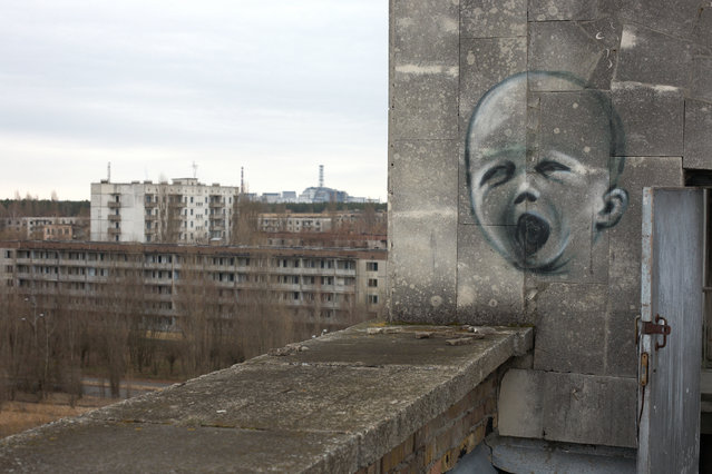Graffiti of a crying baby on a wall, Chernobyl Power Plant, Chernobyl, Ukraine. (Photo by Hans Neleman/Getty Images)