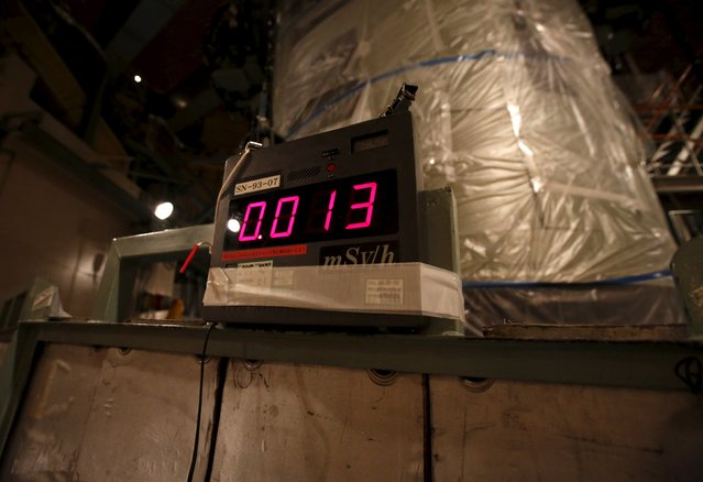 A geiger counter, measuring a radiation level of 0.013 microsievert per hour, is seen inside the No.1 reactor building where fuel rods are being inserted into a reactor vessel at  Kyushu Electric Power's Sendai nuclear power station in Satsumasendai, Kagoshima prefecture, Japan, July 8, 2015. (Photo by Issei Kato/Reuters)