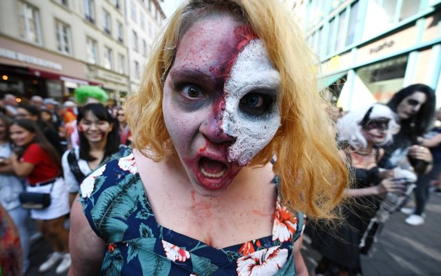 Enthusiast dressed as zombies take part in the Zombie Walk event on September 14, 2019 in the eastern French city of Strasbourg, within the framework of the 12th edition of the European Fantastic Film festival, which runs from September 14 to 22. (Photo by Frederick Florin/AFP Photo)
