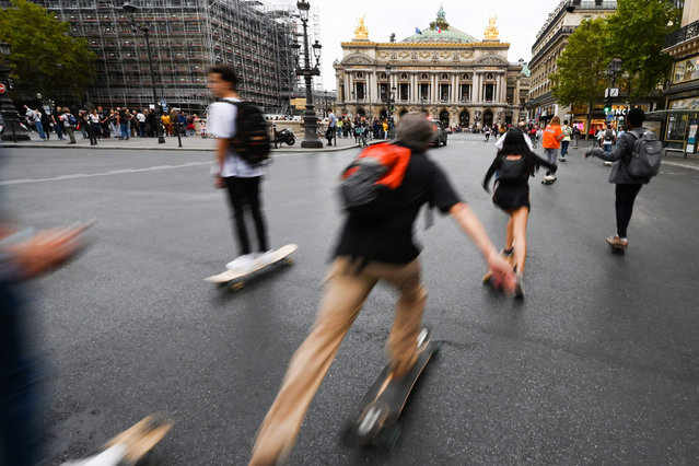 """People skate on the Opera Avenue in the French capital Paris, on September 22, 2019, during the fifth edition of """"day without cars"""". (Photo by Dominique Faget/AFP Photo)"""