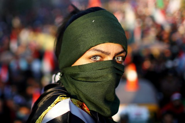 An Iraqi female demonstrator takes part in ongoing anti-government protests in Baghdad, Iraq on November 1, 2019. Tens of thousands of Iraqis thronged central Baghdad on Friday demanding the root-and-branch downfall of the political elite in the biggest day of mass anti-government demonstrations since the fall of Saddam Hussein. (Photo by Ahmed Jadallah/Reuters)