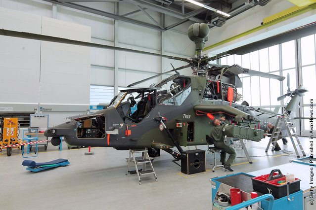 Workers assemble a Eurocopter Tiger military attack helicopter at the Eurocopter plant