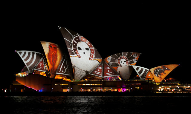 An indigenous Australian design is projected onto the sails of the Sydney Opera House during the opening night of the annual Vivid Sydney light festival in Sydney, Australia May 27, 2016. (Photo by Jason Reed/Reuters)