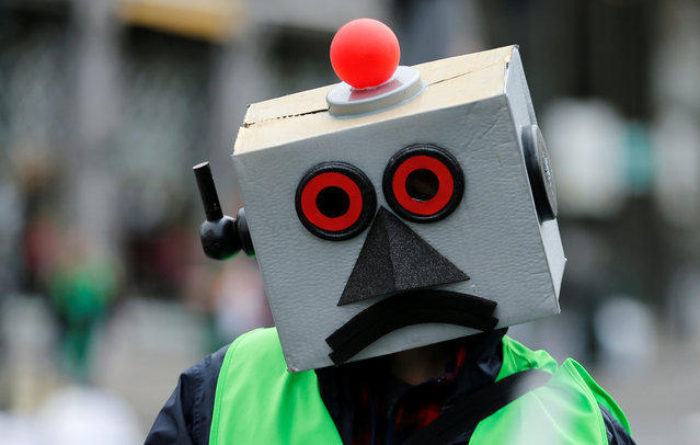 A protester dressed as a robot takes part in a march by Belgian public sector workers in central Brussels, Belgium, May 31, 2016. (Photo by Francois Lenoir/Reuters)