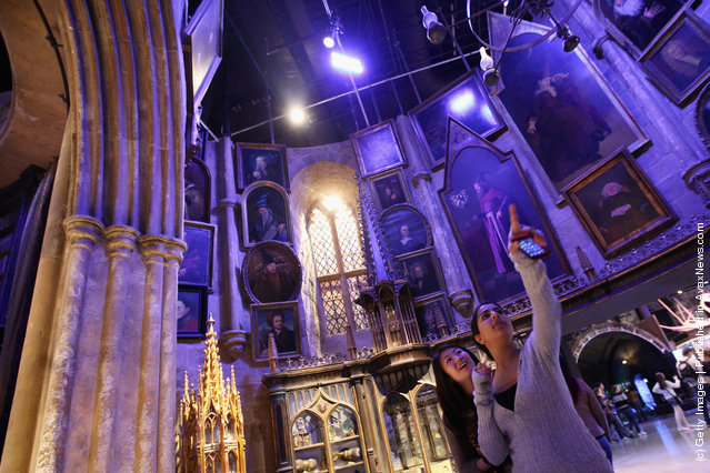 Two girls look around the set of Dumbledore's office at the new Harry Potter Studio Tour at the Warner Brothers Leavesden Studios