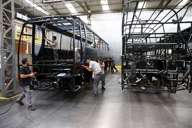 Employees work at the assembly line of the MAN Bus Production Center in Ankara, Turkey, July 29, 2015.  According to a statement from the company, it employs 1,600 workers on the 320,000 square metre plant where seven vehicles are produced a day to be used for the MAN and NEOPLAN brand of city and intercity buses, as well as touring coaches. (Photo by Umit Bektas/Reuters)