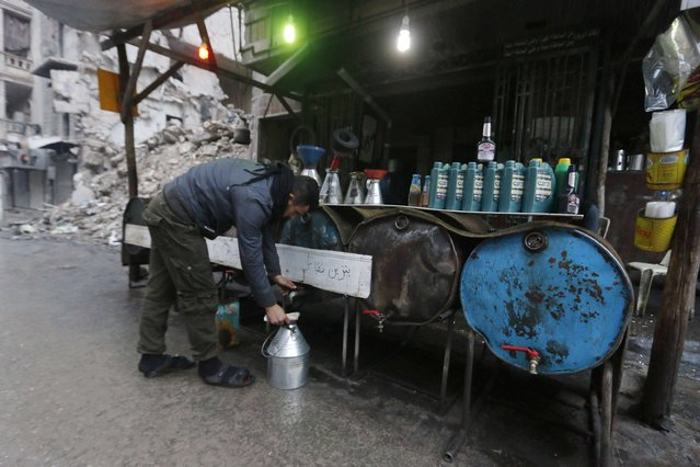 A street vendor sells fuel in the rebel-held area of Aleppo's al-Shaar neighbourhood January 2, 2015. (Photo by Hosam Katan/Reuters)