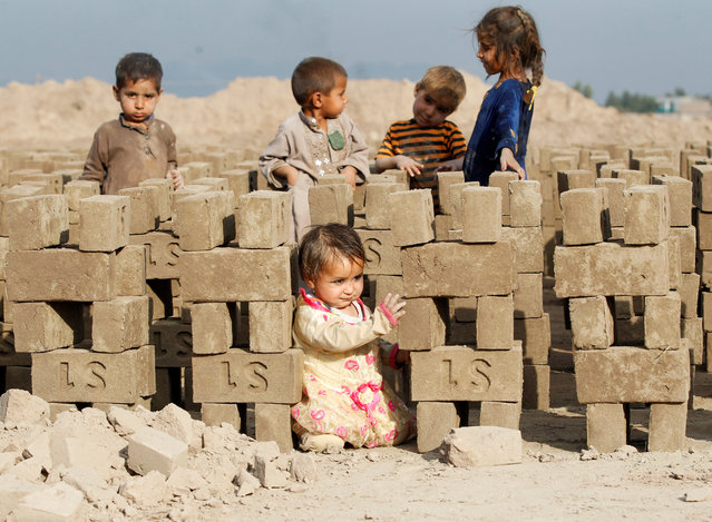 Afghan children play at a brick-making factory on the outskirts of Jalalabad city, eastern Afghanistan on November 13, 2019. (Photo by Reuters/Parwiz)