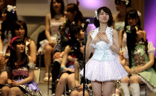 Japan's all-girl pop idol group AKB48 member Yuko Oshima reacts after winning the annual AKB48 popularity poll in Tokyo on June 6, 2012