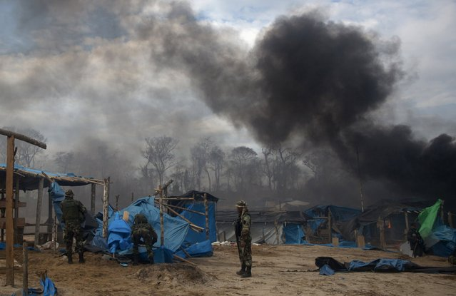 Peruvian police burn illegal miners' camps during an operation against illegal gold mining camps in La Pampa, in the southern Amazon region of Madre de Dios, Peru August 11, 2015. (Photo by Sebastian Castaneda/Reuters)
