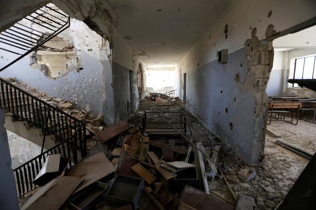 """Damage is seen inside """"Syria, The Hope"""" school on the outskirts of the rebel-controlled area of Maaret al-Numan town, in Idlib province, Syria June 1, 2016. (Photo by Khalil Ashawi/Reuters)"""