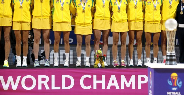 Members of the Australian team stand on the podium wearing their medals with a toy kangaroo in front of the trophy after winning their Netball World Cup final game against New Zealand in Sydney, August 16, 2015. (Photo by David Gray/Reuters)