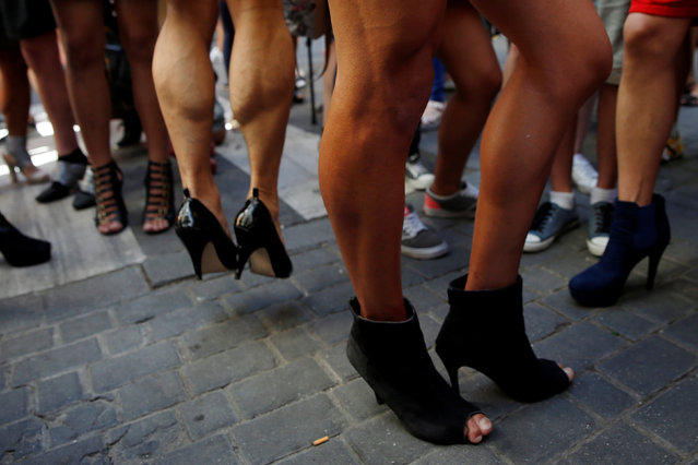 Competitors wait to take part in the annual race on high heels during Gay Pride celebrations in the quarter of Chueca in Madrid, Spain, June 30, 2016. (Photo by Susana Vera/Reuters)