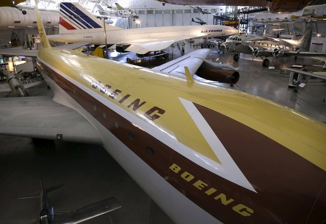 A Boeing 367-80 (prototype to the Boeing 707) (front), a Boeing 307 Stratoliner (rear, R), the first pressurized cabin passenger aircraft, and an Air France Concorde supersonic airliner (rear, C) are seen at the Udvar-Hazy Smithsonian National Air and Space Annex Museum in Chantilly, Virginia August 28, 2015. (Photo by Gary Cameron/Reuters)