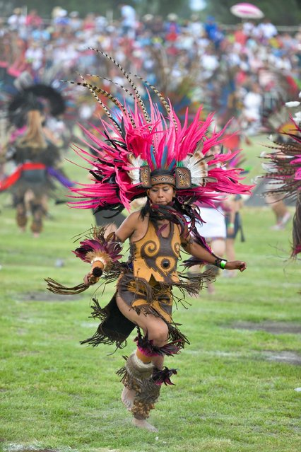 """Dancers of Pre-Hispanic traditional dances perform while attempting to set a Guinness Record of """"The biggest Ceremonial Dance of the world"""", near the Teotihuacan archaeological site, Mexico, on July 17, 2016. (Photo by Mario Vazquez/AFP Photo)"""