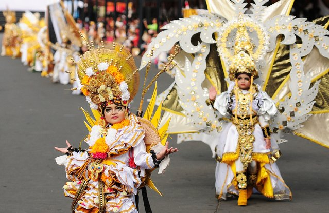 Models wear Mahabharata costume in the kids carnival during The 13th Jember Fashion Carnival 2014 on August 21, 2014 in Jember, Indonesia. (Photo by Robertus Pudyanto/Getty Images)