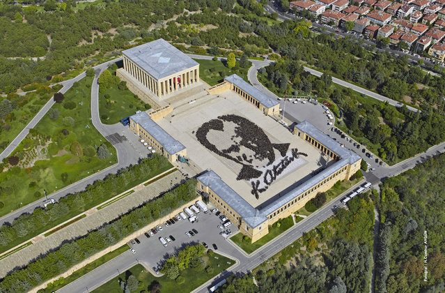 In this aerial photo made available by the Turkish Military, some 6,000 people form a large portrait of Mustafa Kemal Ataturk, the founder of modern Turkey at his mausoleum in Ankara, Turkey, Tuesday, August 26, 2014. August 26, 1922 was the final phase of Turkey's War of Independence led by Ataturk himself. (Photo by AP Photo/Turkish Military)
