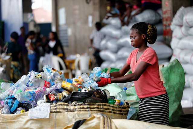 An employee sorts waste at the Wecycler recycling  centre in Ebutte Meta district in Lagos, Nigeria July 28, 2016. (Photo by Akintunde Akinleye/Reuters)