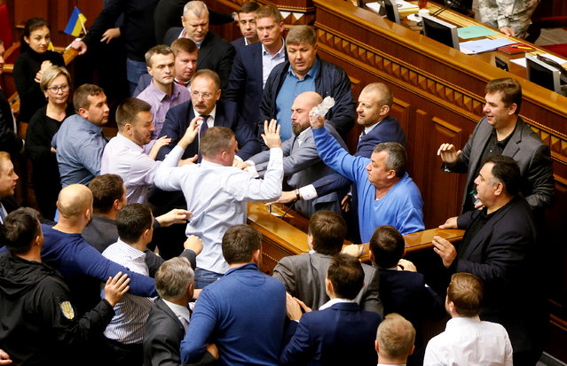 Ukrainian lawmakers scuffle during a parliament session of debate and voting on a law draft to ensure the state sovereignty of Ukraine throughout the rebel-held areas of Donetsk and Luhansk regions, in Kiev, Ukraine October 6, 2017. (Photo by Valentyn Ogirenko/Reuters)