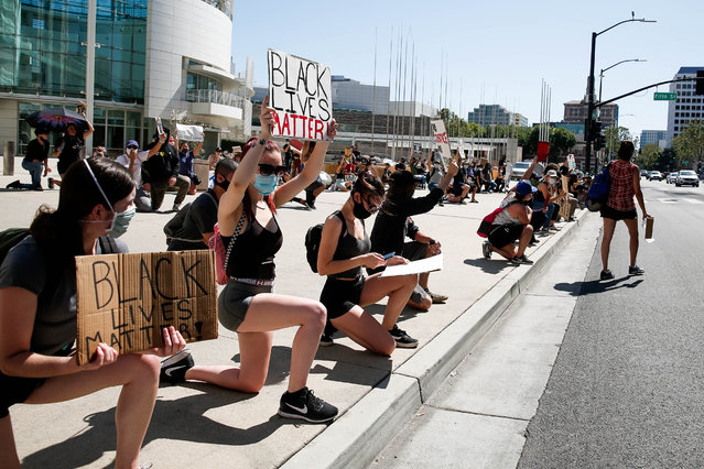 People get down on one knee during a demonstration over the police killing of George Floyd in downtown San Jose, Calif., on Wednesday, June 3, 2020. (Photo by Randy Vazquez/Bay Area News Group)