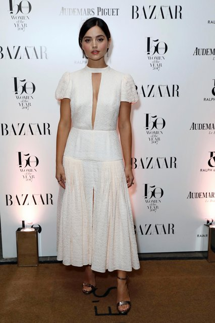 """Actress Jenna Coleman poses for photographers on arrival at the Harpers Bazaar """"Women of the Year"""" Awards 2017, in London, Thursday, November 2, 2017. (Photo by Grant Pollard/Invision/AP Photo)"""