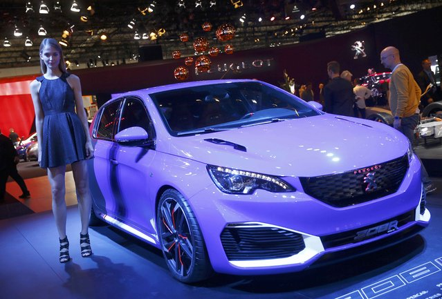 A model poses next to the Peugeot 308 R Hybrid during the media day at the Frankfurt Motor Show (IAA) in Frankfurt, Germany September 15, 2015. (Photo by Kai Pfaffenbach/Reuters)