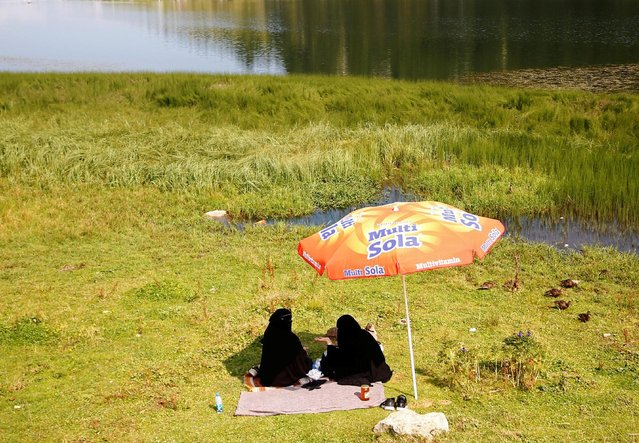 Tourists from the Middle East enjoy on the Prokosko Lake near Fojnica, Bosnia and Herzegovina, August 20, 2016. (Photo by Dado Ruvic/Reuters)