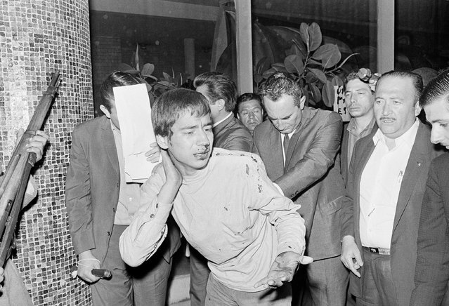 A bleeding youngster weeps as he is arrested by police agents at the Santo Tomas Polytechnic Institute in Mexico City, September 24, 1968, where students and police had a five-hour battle. (Photo by Jesus Diaz/AP Photo)