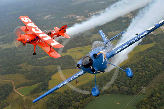 John Klatt and the Air National Guard MXS (right) and Mike Wiskus and the Lucas Oil Pitts take to the skies at the Memphis Airshow, on Sat., September 26, 2016 in Millington, Tenn. (Photo by Brandon Dill/Invision for John Klatt Airshows, Inc./AP Images)