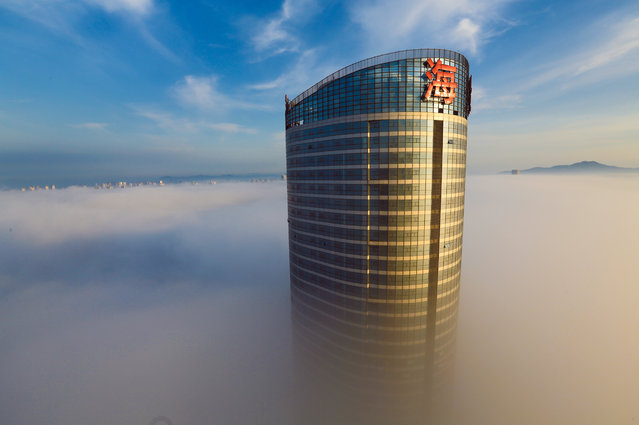 Advection fog surrounds buildings on June 2, 2017 in Rizhao, Shandong Province of China. (Photo by VCG/VCG via Getty Images)