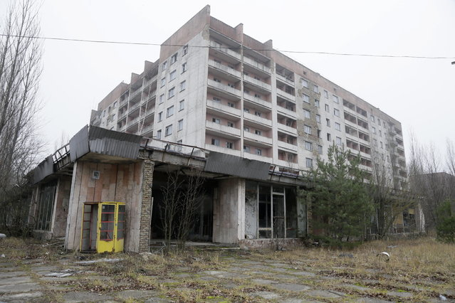A view of empty houses in the deserted town of Pripyat near the closed Chernobyl nuclear power plant Ukraine November 27, 2012. (Photo by Efrem Lukatsky/AP Photo)