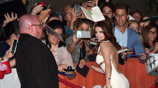 "Actress Anna Kendrick takes a selfie with fans at ""The Last Five Years"" premiere during the 2014 Toronto International Film Festival at Ryerson Theatre on September 7, 2014 in Toronto, Canada. (Photo by Alberto E. Rodriguez/Getty Images)"