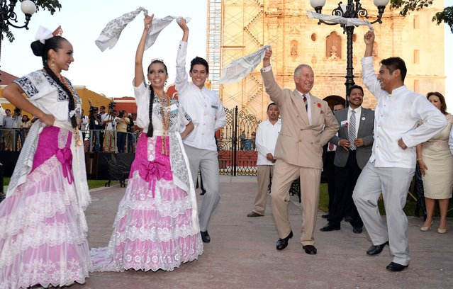 Prince Charles, Prince of Wales takes part in traditional Mexican clog dancing in Zocalo Square on November 4, 2014 in Campeche, Mexico. The Royal Couple are on the second day of a four day visit to Mexico as part of a Royal tour to Colombia and Mexico. The Duchess was scheduled to visit the site today but had to pull out due for health reasons. (Photo by Chris Jackson/Getty Images)