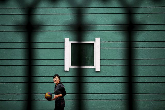 A woman prepares to serve during a game of volleyball in downtown Pyongyang October 8, 2015. (Photo by Damir Sagolj/Reuters)