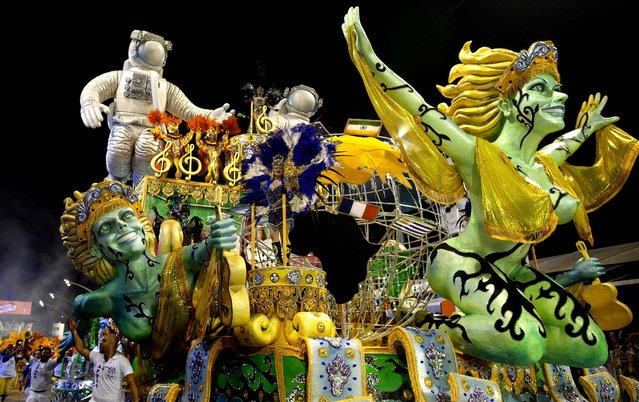 Dancers from the Academicos do Tatuape samba school perform on a float in Sao Paulo. (Photo by Andre Penner/Associated Press)