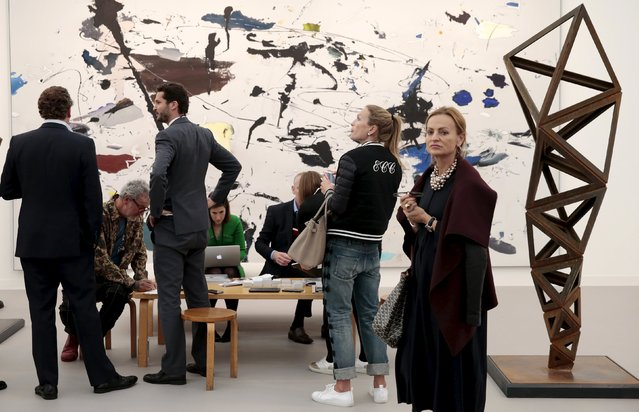 Visitors walk Victoria Miro Gallery installation at the Frieze Art Fair in London, Britain October 14, 2015. (Photo by Suzanne Plunkett/Reuters)