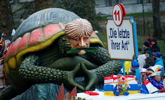 """A carnival float depicting German Chancellor Angela Merkel at the traditional """"Rosenmontag"""" Rose Monday carnival parade in in Mainz, Germany on February 12, 2018. Placard reads """"The last of it's kind"""". (Photo by Ralph Orlowski/Reuters)"""
