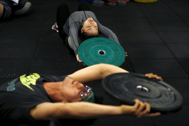 Kim Jin-ah (top), 31, exercises during a crossfit class at a gym in Seoul, September 11, 2015. (Photo by Kim Hong-Ji/Reuters)